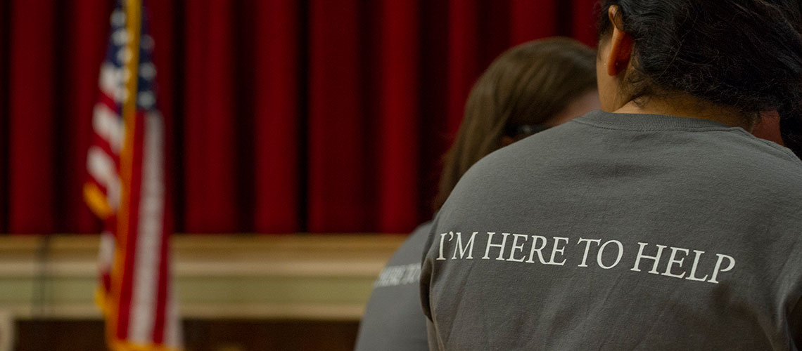 Student with a I'm Here to Help Shirt